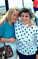Downs syndrome woman and counselor age 40 at Lake Calhoun excursion.  Minneapolis  Minnesota USA