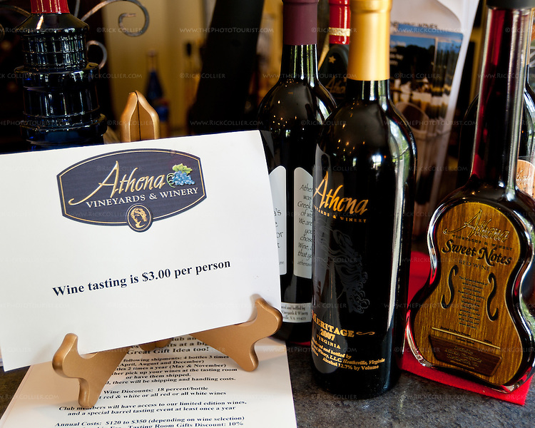 Distinctively shaped wine bottles displayed on the bar invite the visitor to taste at Athena Vineyards and Winery.