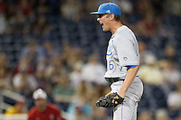 UCLA pitcher David Berg (26) celebrates beating the North Carolina State Wolfpack after Game 8 of the 2013 Men's College World Series on June 18, 2013 at TD Ameritrade Park in Omaha, Nebraska. The Bruins defeated the Wolfpack 2-1, eliminating North Carolina State from the tournament. (Andrew Woolley/Four Seam Images)