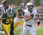 SPEARFISH, SD: SEPTEMBER 2: Corey Brown #6 of Adams State runs past Black Hills State defender Austin Goddard #33 during their game Saturday at Lyle Hare Stadium in Spearfish, S.D.   (Photo by Dick Carlson/Inertia)