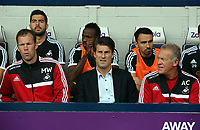 Pictured L-R: Swansea assistant manager Morten Wieghorst, manager Michael Laudrup and first team head coach Alan Curtis. Sunday 01 September 2013<br />