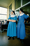 St Mary's at the Cross, Catholic nuns  Members of their community look after the sick. London 1980s.