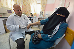 Lab technician Jaber El-Qrinawi draws blood from a patient in a clinic in Rafah, in the south of Gaza. The clinic is run by the Department of Service for Palestinian Refugees of the Near East Council of Churches, a member of the ACT Alliance, and funded in part by the Pontifical Mission for Palestine.