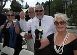 Jennifer and Terry Stern and Kathy Juarez toast during the Pops on the River fundraiser at Wingfield Park in Reno on  Saturday, July 9, 2016.