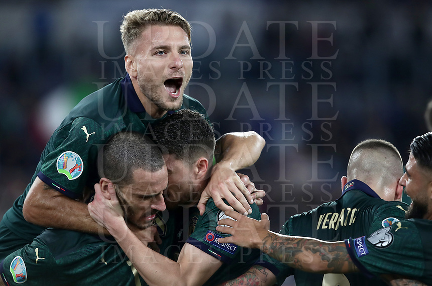 Football: Euro 2020 Group J qualifying football match Italy vs Greece at the Olympic stadium, in Rome, on October 12, 2019.<br /> Italy's Jorginho (c) celebrates after scoring with his team mate Ciro Immobile (top), Leonardo Bonucci (l)  Marco Verratti (second from right) and Lorenzo Insigne (r)  during the Euro 2020 qualifying football match between Italy and Greece at the Olympic stadium, in Rome, on October 12, 2019.<br /> UPDATE IMAGES PRESS/Isabella Bonotto
