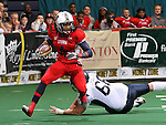 SIOUX FALLS, SD - MARCH 17:  Patrick Wells #4 from the Sioux Falls Storm returns an lateral following an interception past Waler Stuller #66 from the Wyoming Calvary in the second quarter of their game Sunday afternoon at the Sioux Falls Arena. (Photo by Dave Eggen/Inertia)