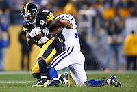 Markus Wheaton #11 of the Pittsburgh Steelers catches a pass in front of Mike Adams #29 of the Indianapolis Colts in the first half during the game at Heinz Field on December 6, 2015 in Pittsburgh, Pennsylvania. (Photo by Jared Wickerham/DKPittsburghSports)