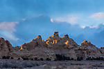 Colorful sculpted Navajo Sandstone formations at sunset in the Head of Sinbad area of the San Rafael Swell in Utah.