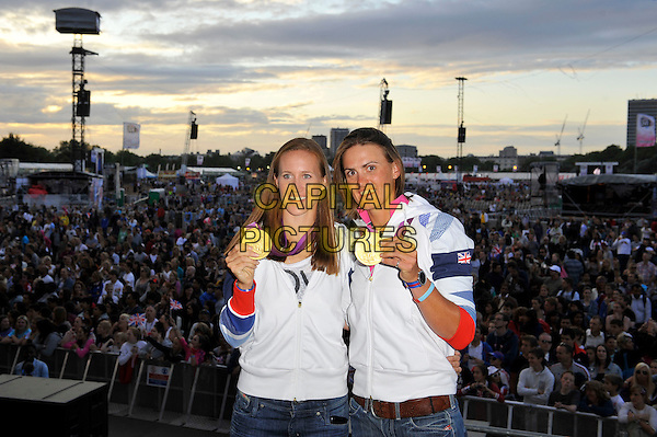 Helen Glover and Heather Stanning, Olympic Gold Medal Winners for Team GB, attending BT London Live, Hyde Park, London, England..2nd August 2012.stage half length white jacket winners rowing rowers.CAP/MAR.© Martin Harris/Capital Pictures.
