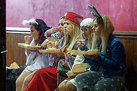 Pictured: A group of women dressed as characters of the Nativity play, eat a take away meal in Wind Street, Swansea, Wales, UK. Friday 20 December 2019<br /> Re: Black Eye Friday (also known as Black Friday, Mad Friday, Frantic Friday) the last Friday before Christmas, in Swansea, Wales, UK.