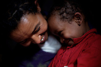 "Tlbech, 27 years old, and her son Zarhiun, 4, both HIV positive, hug right after Tlbech talked about her only reason to live: "" her son"", in their small house in one of the poorest neighborhoods in Addis Ababa, ethiopia on Monday June 05 2006..Talbech and Zarihun live on a 180 birr ( 20 USD ) per month sponsorship from the HfC NGO. they spend 100 Birr for rent leaving less than 10 USD for food and other necessities. Nevertheless they are a privileged family in the country..Tlbech besides fighting againt the virus and taking care of her child provides home base care assistance in Addis to other HIV patients in need..Ethiopia is one of the countries most affected by HIV/AIDS. Of its population of 77 million, three million are HIV-positive, according to government statistics. Every day sees 1,000 new infections. A million children under 14 have lost one or both parents to AIDS, and 200,000 children are living with AIDS. That makes Ethiopia the country with the most HIV-positive children."