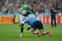 Jamie Heaslip of Ireland is tackled by Matias Aguero of Italy during Match 28 of the Rugby World Cup 2015 between Ireland and Italy - 04/10/2015 - Queen Elizabeth Olympic Park, London<br /> Mandatory Credit: Rob Munro/Stewart Communications