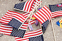 A pile of flags and candy on the street during the 2015 Veteran's Day Parade in downtown Houston.