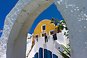Santorini, Greece. 06.05.2014. View of yellow painted home in the mainly whitewashed, mediaeval, village of Finikia. The homes in this village have been constructed in the hyposcafa manner i.e. the lower portions are dug out from the ground. Photogaph © Jane Hobson.