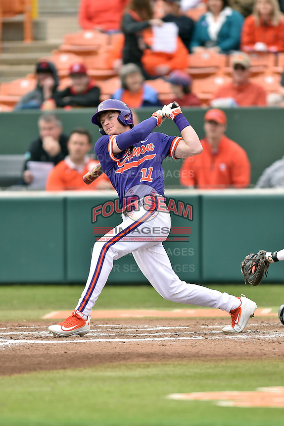 Clemson Tigers third baseman Adam Renwick (11) swings at a pitch during a game against the Maine Black Bears at Doug Kingsmore Stadium on February 20, 2016 in Clemson, South Carolina. The Tigers defeated the Black Bears 9-4. (Tony Farlow/Four Seam Images)