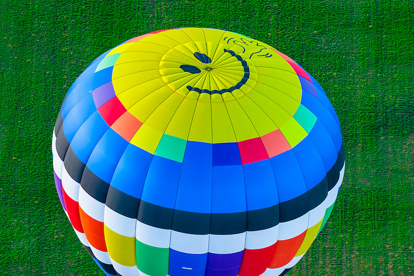 Aerial view of hot air balloon with happy face on top, Albuquerque International Balloon Fiesta, Albuquerque, New Mexico USA.