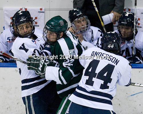 "Brendan Mason (Yale - 22) and Jeff Anderson (Yale - 44) combine forces against Dustin Walsh (Dartmouth - 22). - The Yale University Bulldogs defeated the visiting Dartmouth College Big Green 7-3 in the ""Ivy Shootout"" championship game on Saturday, October 30, 2010, at Ingalls Rink in New Haven, Connecticut."