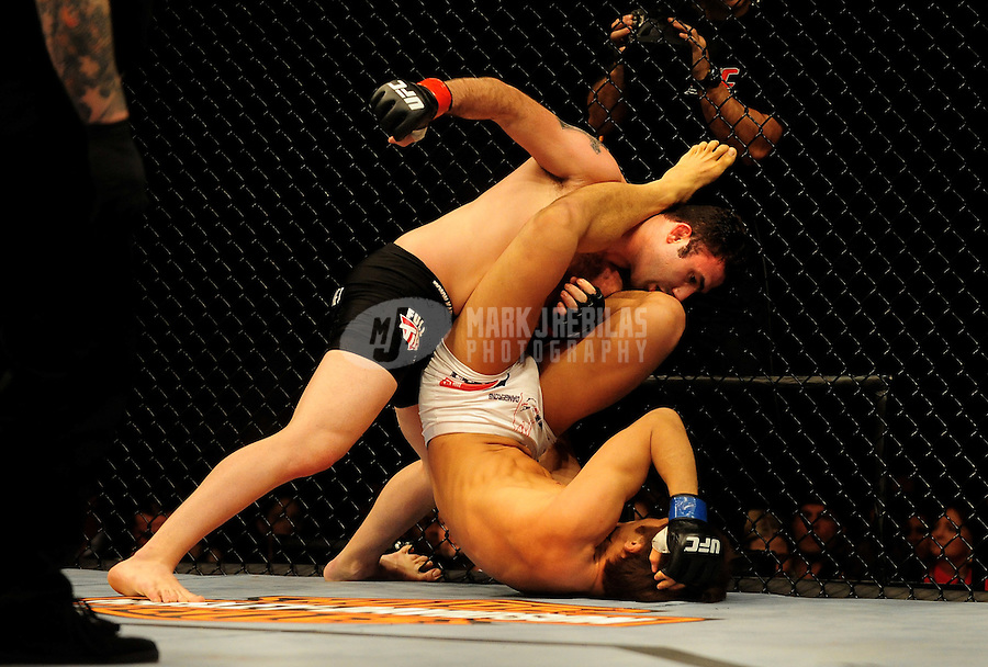 Jan. 31, 2009; Las Vegas, NV, USA; UFC fighter Karo Parisyan (black trunks) punches Dong Hyun Kim (white trunks) during the welterweight bout in UFC 94 at the MGM Grand Hotel and Casino. Mandatory Credit: Mark J. Rebilas-