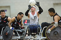 27 MAY 2013 - DONCASTER, GBR - Aaron Phipps (second from right) of the South Wales Pirates catches the ball during the 2013 Great Britain Wheelchair Rugby Nationals bronze medal match against West Coast Crash at The Dome in Doncaster, South Yorkshire .(PHOTO (C) 2013 NIGEL FARROW)