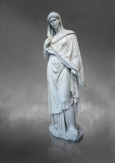 Roman funerary statue of a women in the Large Herculaneum style, Found in the cemetery of Stagiou Street, Athens, Athens Archaeological Museum, cat no 32622.  against grey<br /> <br /> This statue is the typle known as the Large Herculaneum Wome. She wears a full length chiton and himation that covers her head and entire body. Dating from the 1st cent AD it is a copy of an earlier statue circa 320 BC, probably by Praxiteles