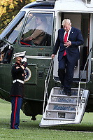 United States President Donald J. Trump walks out of Marine One on the South Lawn of the White House upon his return to Washington from South Korea on June 30, 2019 in Washington, DC. Photo Credit: Oliver Contreras/CNP/AdMedia