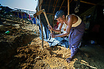 Kamal Hasom digs a platform for his family's makeshift shelter in the Mainerghona Refugee Camp near Cox's Bazar, Bangladesh, on October 27, 2017. <br /> <br /> Hasom said he and his family fled their village in Myanmar in late September after their house was burned by that country's military. In Bangladesh they have received food supplies from Caritas.<br /> <br /> Since August more than 600,000 Rohingya have fled Myanmar for safety in Bangladesh.