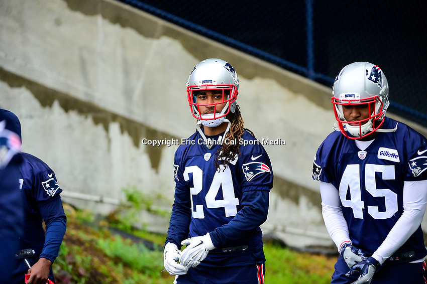 June 6, 2017: New England Patriots cornerback Stephon Gilmore (24) walks to practice in the rain at the New England Patriots mini camp held on the practice field at Gillette Stadium, in Foxborough, Massachusetts. Eric Canha/CSM