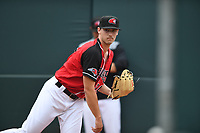 Hickory Crawdads starting pitcher Cole Winn (24) warms up in the bullpen prior to the game with the Lexington Legends at L.P. Frans Stadium on May 22, 2019 in Hickory, North Carolina.  The Legends defeated the Crawdads 8-3. (Tracy Proffitt/Four Seam Images)