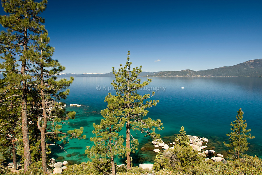Lake Tahoe is a large freshwater lake in the Sierra Nevada mountains of the United States. It is located along the border between California and Nevada, west of Carson City, Nevada. Lake Tahoe is the largest alpine lake in the United States. Its depth is 514 m making it America's second-deepest. The lake is known for the clarity of its water and the panorama of surrounding mountains on all sides. (wikipedia_Lake Tahoe)