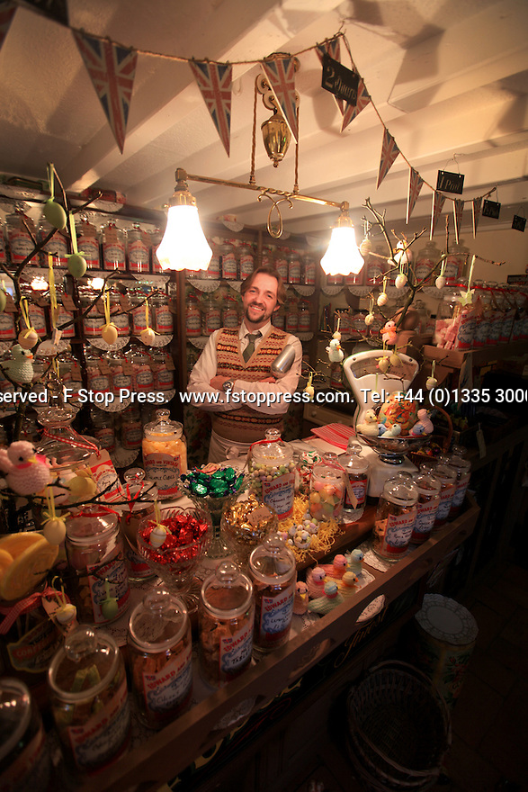 Picture dated 06/03/13 shows David Westcott-Walker (40) behind the counter of his traditional sweet shop, Edward and Vintage, Tissington, Derbyshire.<br />