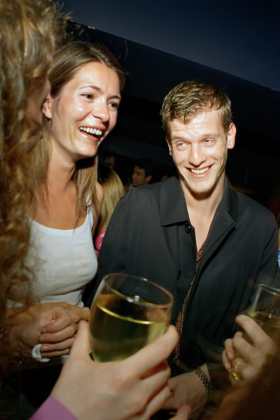 writer/socialite Plum Sykes and painter Damian Loeb at the Marie Claire party at the Lotus club, NYC, 2000