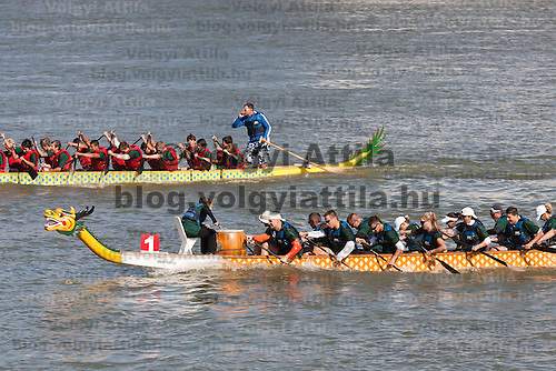 Dragonboats paddle on river Danube in front of the Parliament as part of the Hungarian rotational EU presidency closing celebrations in Budapest, Hungary on June 25, 2011. ATTILA VOLGYI