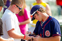 Bryce Harper #34 of the Hagerstown Suns autographs a jersey for a fan following the game against the Kannapolis Intimidators at Fieldcrest Cannon Stadium on May 30, 2011 in Kannapolis, North Carolina.   Photo by Brian Westerholt / Four Seam Images