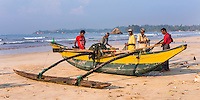 Panoramic photo of fisherman sorting their catch on Weligama Beach, South Coast of Sri Lanka, Asia. This is a panoramic photo of fisherman sorting their catch on Weligama Beach, South Coast of Sri Lanka, Asia.