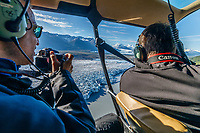 Photographers fly and photograph in helicopter at Colony Glacier with doors off for aerial photography fly over Knik Glacier in Southcentral, Alaska  summer<br /> <br /> Photo by Jeff Schultz/SchultzPhoto.com  (C) 2018  ALL RIGHTS RESERVED