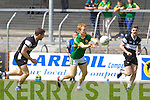 Thomas Hickey of Kerry breaks through Luke Bree and Robert Reid of Sligo in the GAA Football All-Ireland Junior Championship Semi Final last Saturday in Cusack Park, Ennis.