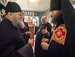 Archimandrite Irinei, greets the monks and clergy during the First Monastic Liturgy, St. Silhouan Monastery, Columbia, California.