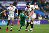 Ben Te'o of England fends Johnny Sexton of Ireland. Natwest 6 Nations match between England and Ireland on March 17, 2018 at Twickenham Stadium in London, England. Photo by: Patrick Khachfe / Onside Images