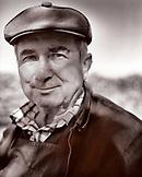 AUSTRIA, Morbisch, portrait of farmer Fischl Helmut during harvest, Burgenland (B&W)