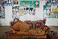 A supporter of Nawaz Sharif's Pakistan Muslim League - Nawaz (PML-N) sleeps after a long night at one of party's election headquarters in Lahore May 12, 2013. Toppled in a 1999 military coup, jailed and exiled, Pakistan's Nawaz Sharif has made a triumphant election comeback and looks set to form a stable government capable of implementing reforms needed to rescue the fragile economy. REUTERS/Damir Sagolj (PAKISTAN)