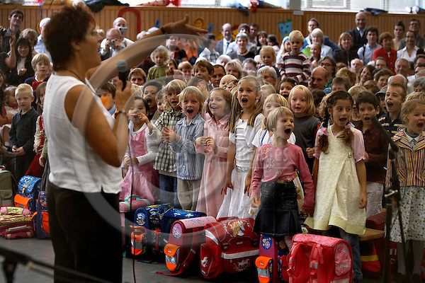 "BERLIN - GERMANY 26. AUGUST 2006 -- First graders first day in school, here the Papageno basic primary school in Berlin-Mitte. The school leader greets the new school children in the entertaining program made by the older pupils, whereafter the new school children gets a traditional Zuckert¸te (a large cornet of cardboard filled with sweets and little presents) to sweeten their new hard working life -- PHOTO: CHRISTIAN T. JOERGENSEN / EUP & IMAGES..This image is delivered according to terms set out in ""Terms - Prices & Terms"". (Please see www.eup-images.com for more details)"