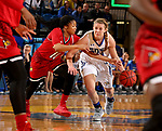 BROOKINGS, SD - DECEMBER 3: Myah Selland #44 from South Dakota State dribbles the ball as Arica Carter #11 from Louisville reaches in during their game Sunday afternoon at Frost Arena in Brookings, SD.  (Photo by Dave Eggen/Inertia)