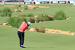 Graeme McDowell plays his 2nd shot on the 18th hole during Day 2 of the Dubai World Championship, Earth Course, Jumeirah Golf Estates, Dubai, 26th November 2010..(Picture Eoin Clarke/www.golffile.ie)