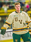 29 December 2013:  University of Vermont Catamount Forward Matt White, a Senior from McMurray, PA, prepares for the final game of the Catamount Cup NCAA Hockey Tournament against the Canisius College Golden Griffins at Gutterson Fieldhouse in Burlington, Vermont. The Catamounts defeated the Golden Griffins 6-2 to win the 2013 Sheraton/TD Bank Catamount Catamount Cup. Mandatory Credit: Ed Wolfstein Photo *** RAW (NEF) Image File Available ***