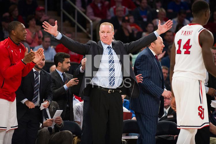 NEW YORK, NY - Sunday December 13, 2015: St. John's University Head Coach Chris Mullin makes gestures on the sidelines.  The St. John's Red Storms takes on the Syracuse Orangemen during the NCAA men's basketball regular season at Madison Square Garden in New York City.