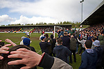 Home supporters encroaching on the pitch during the closing stages of the second-half at Key's Park during the Hednesford Town (in white) versus FC United of Manchester Northern Premier League premier division play-off final. The match would decide which club were promoted to the Blue Square Conference North. Hednesford won the game by 2 goals to 1 in front of a stadium record attendance of 4412 spectators.