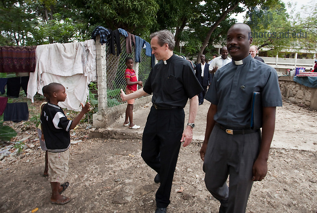 Fr. John Jenkins greets a student at the Ecole Basil Moreau in Port-Au-Prince, Haiti March 4, 2010. Fr. Jenkins led a University delegation to Haiti to visit the Notre Dame Haiti programs as well as Congregation of Holy Cross schools and facilities in the wake of the Jan. 12, 2010 Haiti Earthquake...Photo by Matt Cashore/University of Notre Dame
