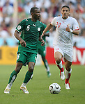 14 June 2006: Omar Al Ghamdi (KSA) (6) is tracked by Hamed Namouchi (TUN) (20). Tunisia and Saudi Arabia tied 2-2 at the Allianz Arena in Munich, Germany in match 16, a Group H first round game, of the 2006 FIFA World Cup.