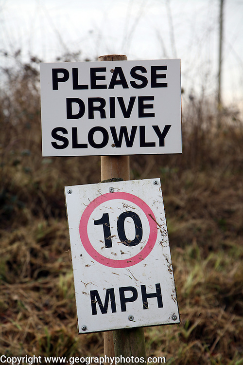 Please drive slowly sign with 10 mph sign