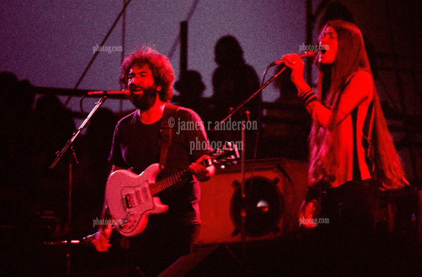 The Grateful Dead Live in Concert at Roosevelt Stadium on 4 August 1976. Jerry Garcia and Donna Jean Godchaux Singing during the First Set. No Record of which Song. But it's possible to determine from Show Setlist/Playback. A slightly different look to this scan from the other one seen in this gallery.